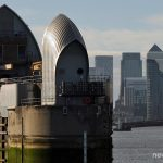 A view of a Thames Barrier with Canary Wharf