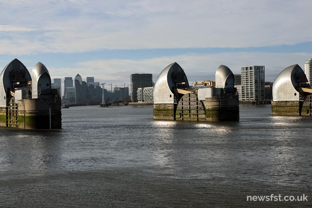 The Thames Barrier, with Canary Wharf