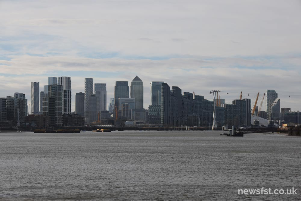 A view of Canary Wharf from the Thames Path, near the Thames Barrier